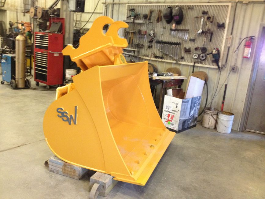 Combine Mud Scrapers Buckets  Attachments Tilting Excavator Bucket  Sunland Steel Works - Custom Welding  Manufacturing in Altona Southern Manitoba Steel Sales Custom Design Friendly Breaking and Bending Shearing and Cutting Machining Laser Cutting CNC Plasma and Water Jet Cutting Sheet Metal Forming and Rolling Pipe Bending and Rolling Painting Powder Coating and Galvanizing